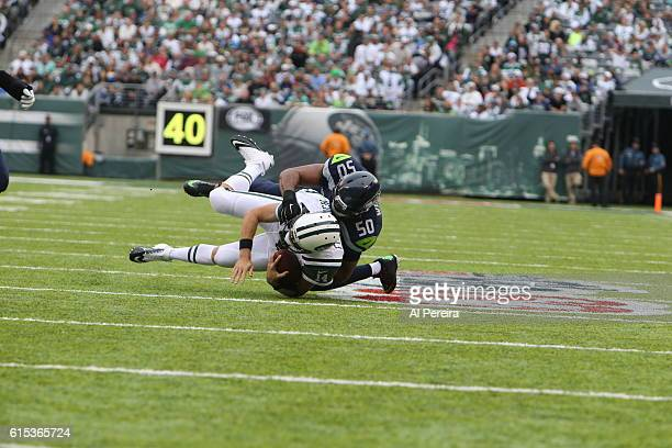 Outside Linebacker K J Wright of the Seattle Seahawks sacks Quarterback Ryan Fitzpatrick of the New York Jets during their game at MetLife Stadium on...