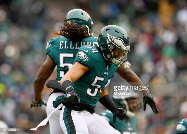 Outside linebacker Kamu GrugierHill and linebacker Dannell Ellerbe of the Philadelphia Eagles celebrate against the Dallas Cowboys during the first...