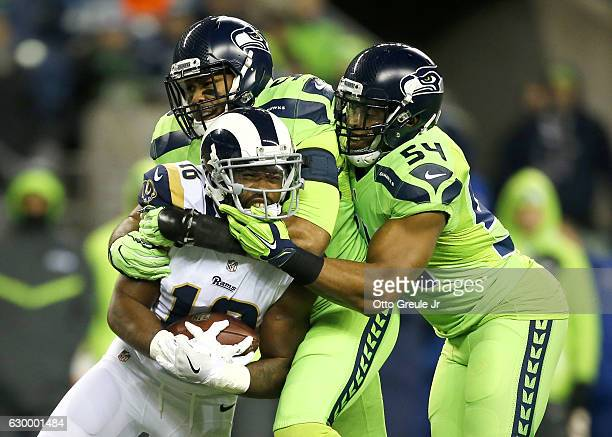 Outside linebacker KJ Wright of the Seattle Seahawks and middle linebacker Bobby Wagner of the Seattle Seahawks team up to bring down Wide receiver...