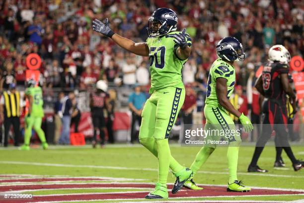 Outside linebacker KJ Wright of the Seattle Seahawks celebrate a turnover on downs against in the second half of the NFL game against the Arizona...