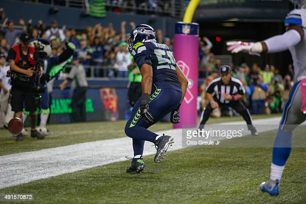 Outside linebacker KJ Wright of the Seattle Seahawks looks at the ball after he tapped it out of the end zone following a fumble at the goal line by...