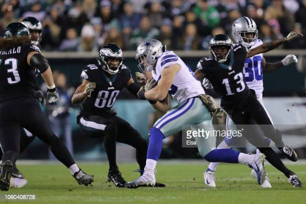 Outside linebacker Leighton Vander Esch of the Dallas Cowboys carries the ball against wide receiver Nelson Agholor and wide receiver Jordan Matthews...