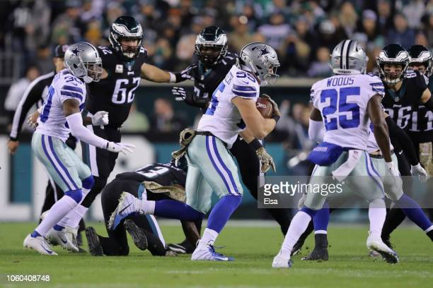 Outside linebacker Leighton Vander Esch of the Dallas Cowboys carries the ball against the Philadelphia Eagles after intercepting the ball from...