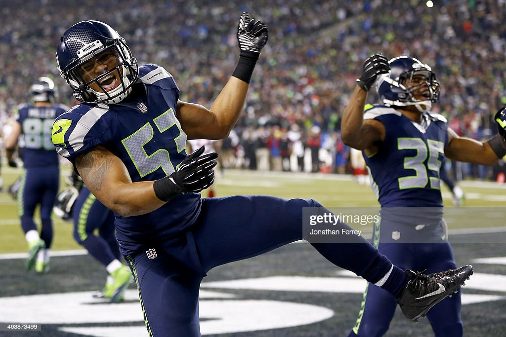 Outside linebacker Malcolm Smith #53 and defensive back DeShawn Shead #35 celebrate after Smith intercepts a pass in the endzone to win the game for the Seahawks against the San Francisco 49ers during the 2014 NFC Championship at CenturyLink Field on January 19, 2014 in Seattle, Washington.