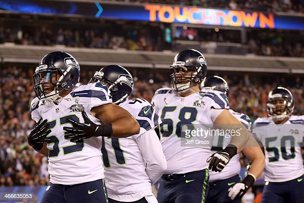 Outside linebacker Malcolm Smith of the Seattle Seahawks celebrates his 69yard touchdown with teammates after intercepting a pass thrown by...