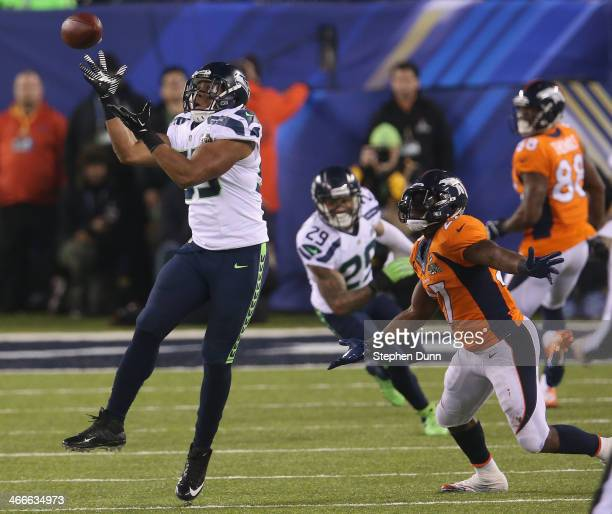Outside linebacker Malcolm Smith of the Seattle Seahawks intercepts a pass intended for running back Knowshon Moreno of the Denver Broncos to run it...