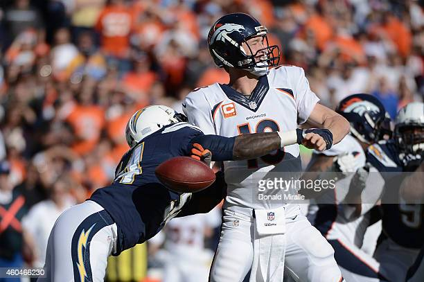 Outside linebacker Melvin Ingram of the San Diego Chargers tackles quarterback Peyton Manning of the Denver Broncos for a loss at Qualcomm Stadium on...