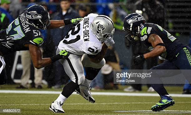 Outside linebacker Mike Morgan and free safety Earl Thomas of the Seattle Seahawks close in to tackle running back Maurice Jones-Drew of the Oakland...