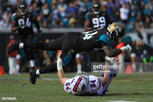 Outside linebacker Myles Jack of the Jacksonville Jaguars breaks up a pass intended for tight end Nick O'Leary of the Buffalo Bills in the third...