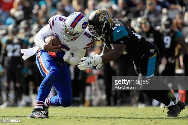 Outside linebacker Myles Jack of the Jacksonville Jaguars tackles quarterback Tyrod Taylor of the Buffalo Bills in the second quarter during the AFC...