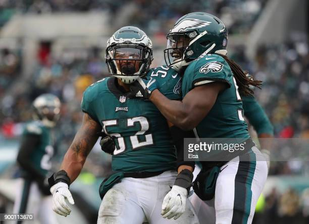Outside linebacker Najee Goode and linebacker Dannell Ellerbe of the Philadelphia Eagles celebrate a play against the Dallas Cowboys during the...