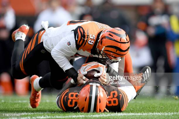 Outside linebacker Nick Vigil of the Cincinnati Bengals intercepts a pass intended for tight end David Njoku of the Cleveland Browns during the first...