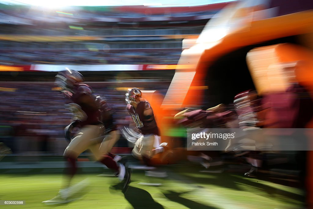 Outside linebacker Ryan Kerrigan #91 of the Washington Redskins runs onto the field prior to a game against the Minnesota Vikings at FedExField on November 13, 2016 in Landover, Maryland.