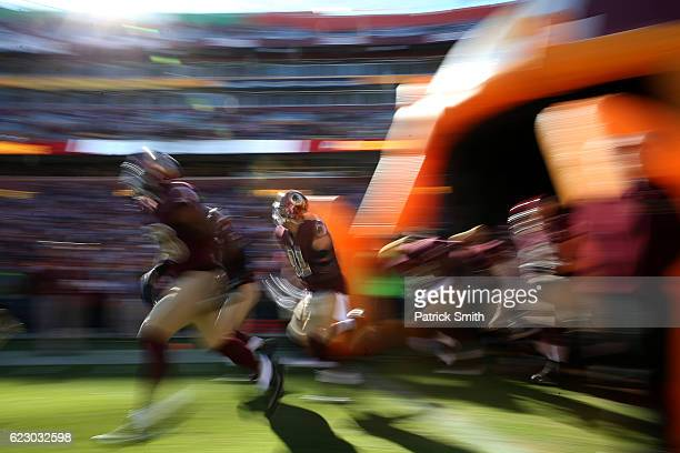 Outside linebacker Ryan Kerrigan of the Washington Redskins runs onto the field prior to a game against the Minnesota Vikings at FedExField on...