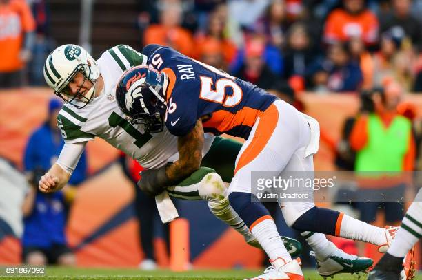 Outside linebacker Shane Ray of the Denver Broncos hits quarterback Josh McCown of the New York Jets on a play where McCown would appear to injure...