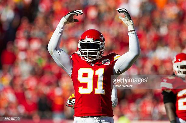 Outside linebacker Tamba Hali of the Kansas City Chiefs attempts to pumps up the crowd on fourth down during the game against the Cleveland Browns at...
