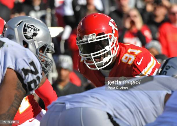 Outside linebacker Tamba Hali of the Kansas City Chiefs looks across the line against the Oakland Raiders during the first half at Arrowhead Stadium...
