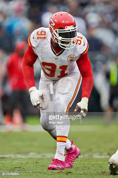 Outside linebacker Tamba Hali of the Kansas City Chiefs prepares to rush against the Oakland Raiders in the fourth quarter on October 16 2016 at...