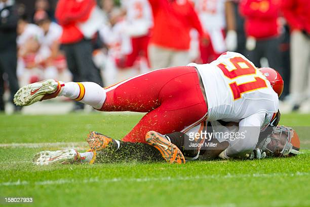 Outside linebacker Tamba Hali of the Kansas City Chiefs sacks quarterback Brandon Weeden of the Cleveland Browns during the first half at Cleveland...