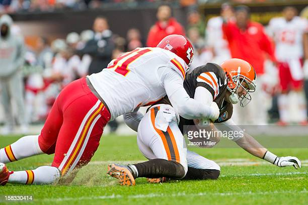 Outside linebacker Tamba Hali of the Kansas City Chiefs sacks quarterback Brandon Weeden of the Cleveland Browns during the game against the...