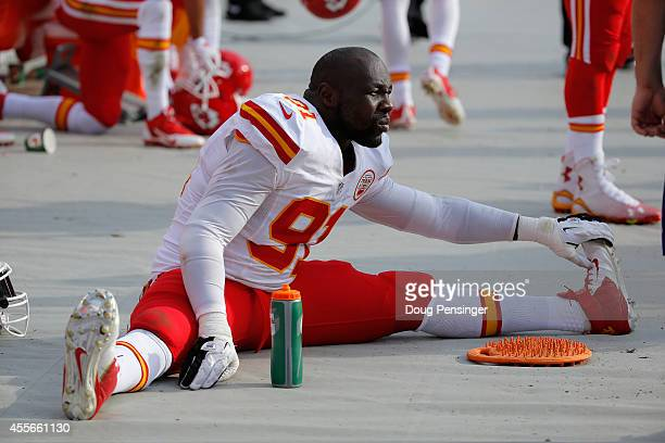 Outside linebacker Tamba Hali of the Kansas City Chiefs stretches on the sidelines against the Denver Broncos at Sports Authority Field at Mile High...