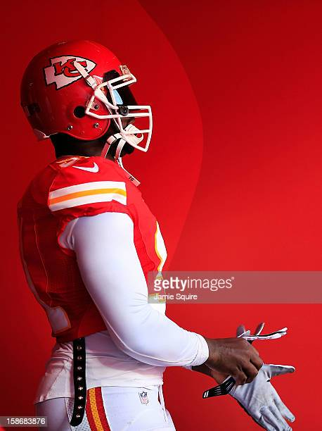 Outside linebacker Tamba Hali of the Kansas City Chiefs walks onto the field prior to the game against the Indianapolis Colts at Arrowhead Stadium on...