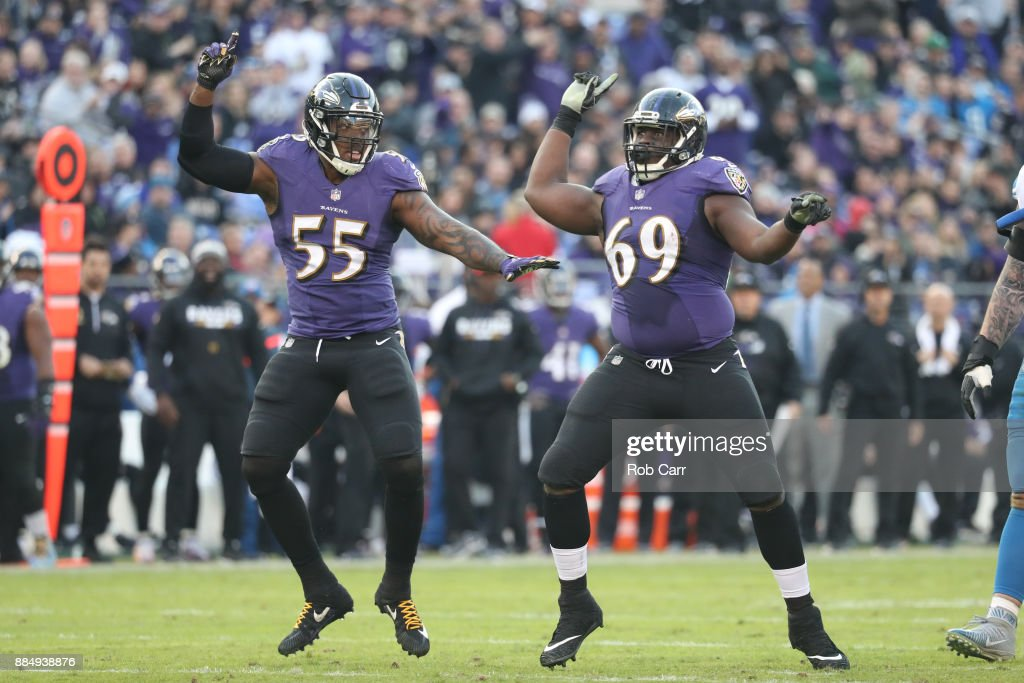 Outside Linebacker Terrell Suggs #55 and defensive tackle Willie Henry #69 of the Baltimore Ravens celebrate after a sack in the fourth quarter against the Detroit Lions at M&T Bank Stadium on December 3, 2017 in Baltimore, Maryland.