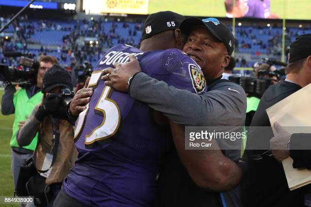 Outside Linebacker Terrell Suggs of the Baltimore Ravens and head coach Jim Caldwell of the Detroit Lions hug after the Ravens 44-20 win over the...