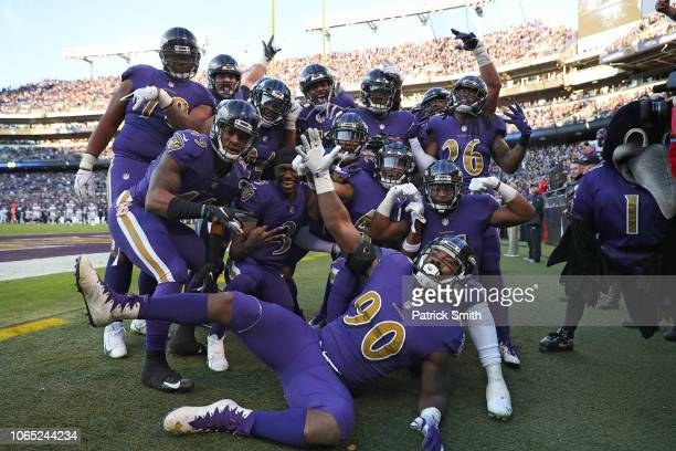 Outside linebacker Terrell Suggs of the Baltimore Ravens celebrates his touchdown after a fumble recovery against the Oakland Raiders with teammates...
