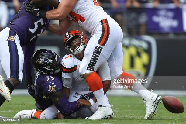 Outside linebacker Terrell Suggs of the Baltimore Ravens forces a fumble as he tackles quarterback DeShone Kizer of the Cleveland Browns during the...