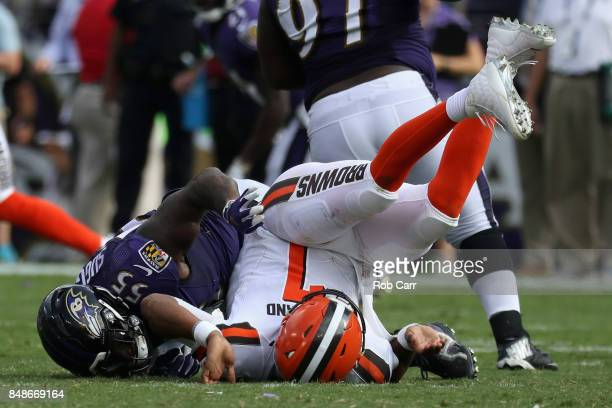 Outside linebacker Terrell Suggs of the Baltimore Ravens hits quarterback DeShone Kizer of the Cleveland Browns in the second half at MT Bank Stadium...