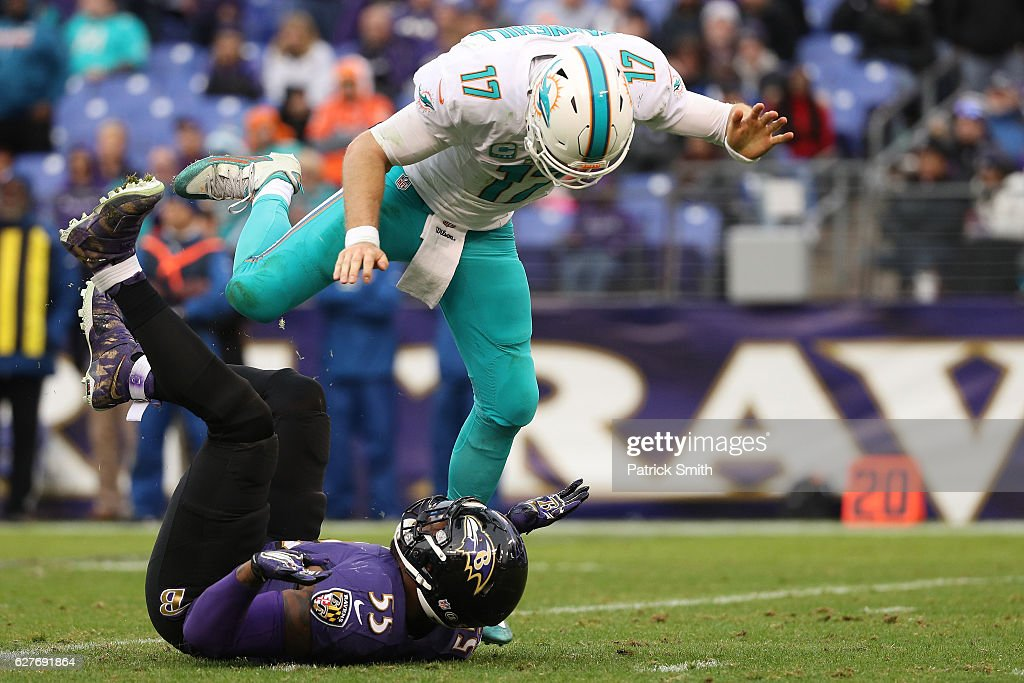 Outside linebacker Terrell Suggs #55 of the Baltimore Ravens hits quarterback Ryan Tannehill #17 of the Miami Dolphins in the fourth quarter at M&T Bank Stadium on December 4, 2016 in Baltimore, Maryland.