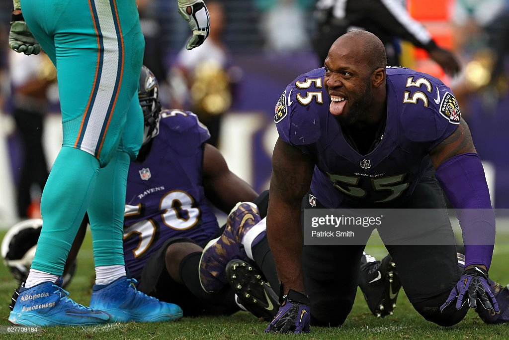 Outside linebacker Terrell Suggs #55 of the Baltimore Ravens reacts after hitting quarterback Ryan Tannehill #17 of the Miami Dolphins (not pictured) in the third quarter at M&T Bank Stadium on December 4, 2016 in Baltimore, Maryland.