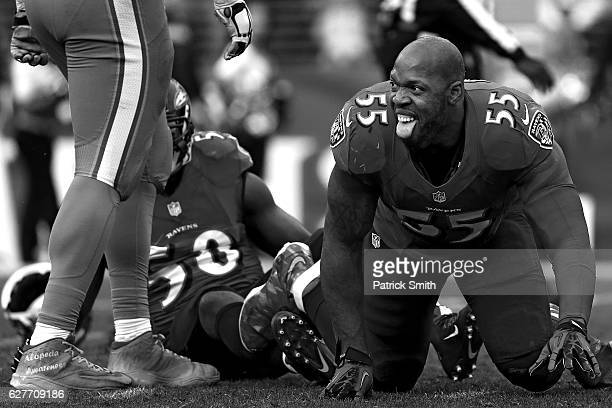 Outside linebacker Terrell Suggs of the Baltimore Ravens reacts after hitting quarterback Ryan Tannehill of the Miami Dolphins in the third quarter...
