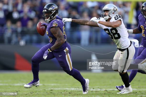Outside Linebacker Terrell Suggs of the Baltimore Ravens runs back a fumble for a touchdown in the fourth quarter against the Oakland Raiders at MT...
