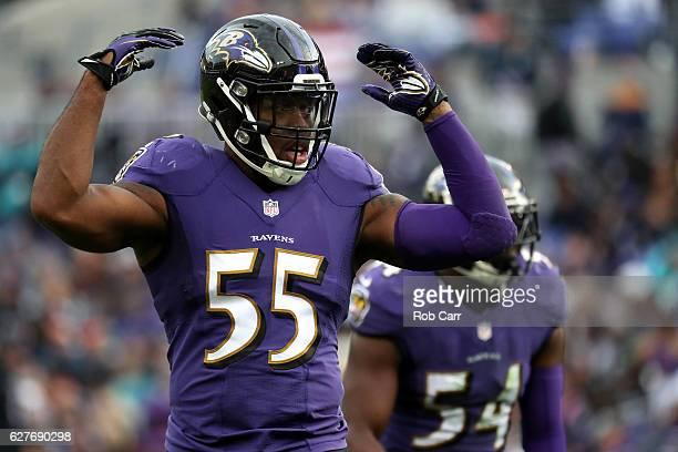 Outside linebacker Terrell Suggs of the Baltimore Ravens signals to the crowd during the third quarter against the Miami Dolphins at MT Bank Stadium...