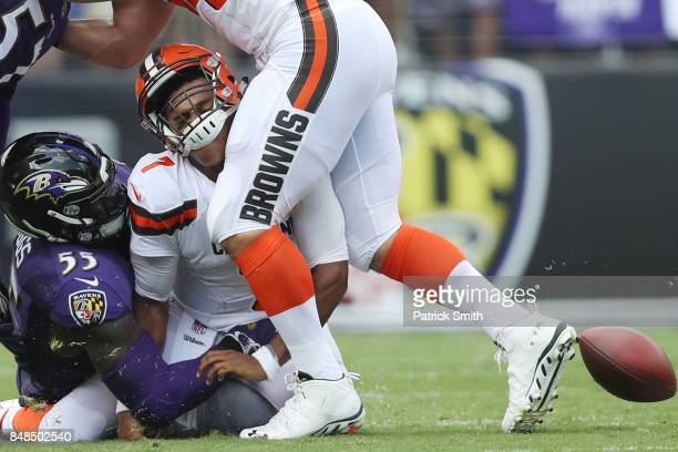 Outside linebacker Terrell Suggs of the Baltimore Ravens tackles quarterback DeShone Kizer of the Cleveland Browns in the first quarter at MT Bank...