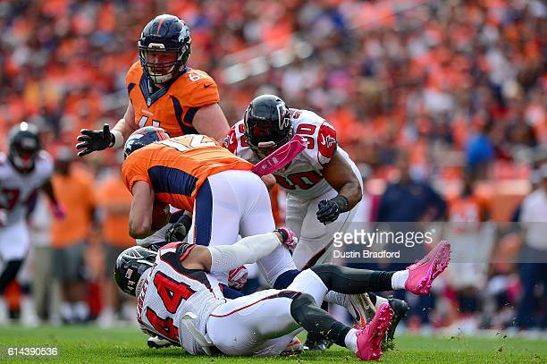 Outside linebacker Vic Beasley and Derrick Shelby of the Atlanta Falcons combine to sack quarterback Paxton Lynch of the Denver Broncos in the first...