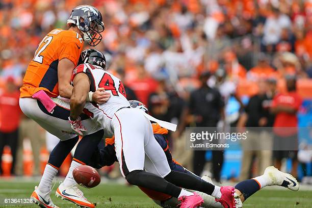 Outside linebacker Vic Beasley of the Atlanta Falcons causes quarterback Paxton Lynch of the Denver Broncos to fumble in the third quarter of the...