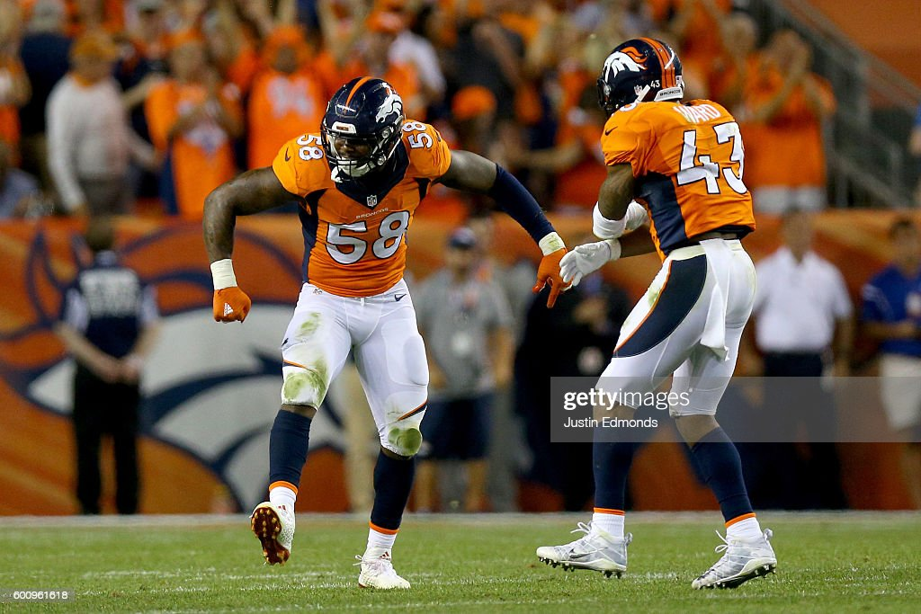 Outside linebacker Von Miller #58 and strong safety T.J. Ward #43 of the Denver Broncos celebrate a Miller sack against the Carolina Panthers late in the fourth quarter at Sports Authority Field at Mile High on September 8, 2016 in Denver, Colorado.