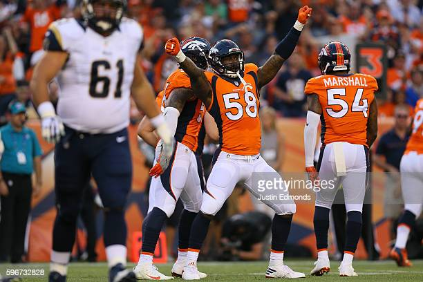 Outside linebacker Von Miller of the Denver Broncos celebrates a first quarter sack against the Los Angeles Rams at Sports Authority Field at Mile...