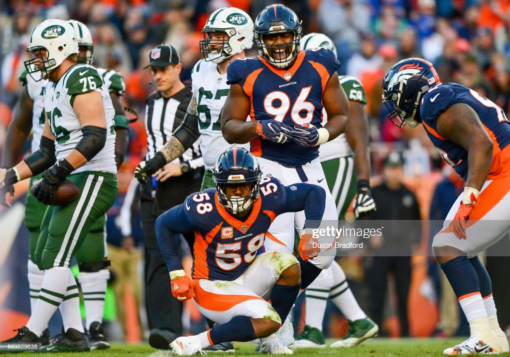 Outside linebacker Von Miller #58 of the Denver Broncos celebrates along with Shelby Harris #96 after a sack against the New York Jets in the third quarter of a game at Sports Authority Field at Mile High on December 10, 2017 in Denver, Colorado.
