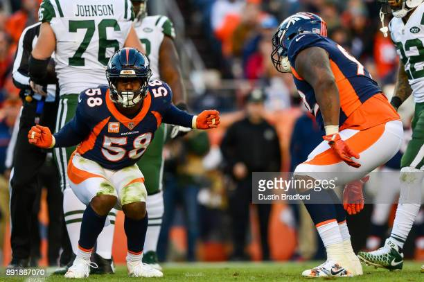 Outside linebacker Von Miller of the Denver Broncos celebrates along with nose tackle Zach Kerr after a sack against the New York Jets in the third...