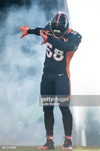 Outside linebacker Von Miller of the Denver Broncos performs a 'dab' pose as he is introduced during player introductions before a game against the...