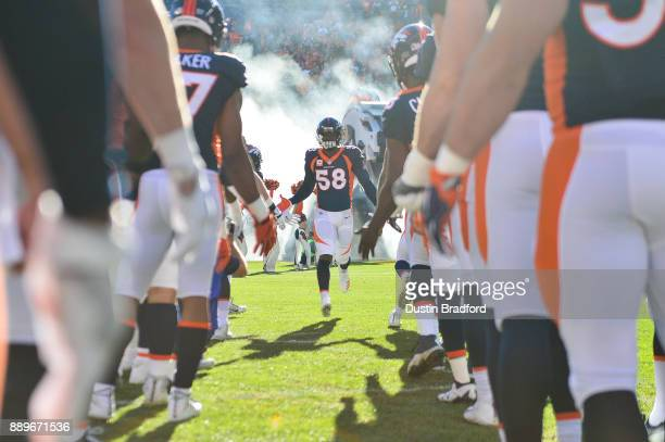 Outside linebacker Von Miller of the Denver Broncos runs onto the field during player introductions before a game against the New York Jets at Sports...
