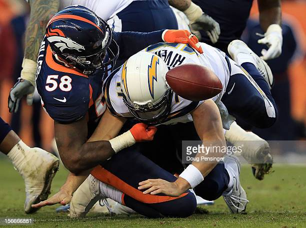 Outside linebacker Von Miller of the Denver Broncos tackles quarterback Philip Rivers of the San Diego Chargers forcing a fumble that was recovered...