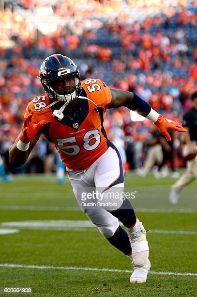 Outside linebacker Von Miller of the Denver Broncos warms up before taking on the Carolina Panthers at Sports Authority Field at Mile High on...