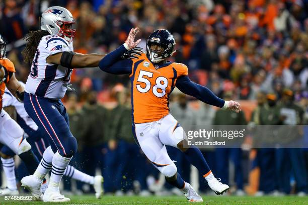 Outside linebacker Von Miller of the Denver Broncos works around a block attempt by offensive tackle LaAdrian Waddle of the New England Patriots at...