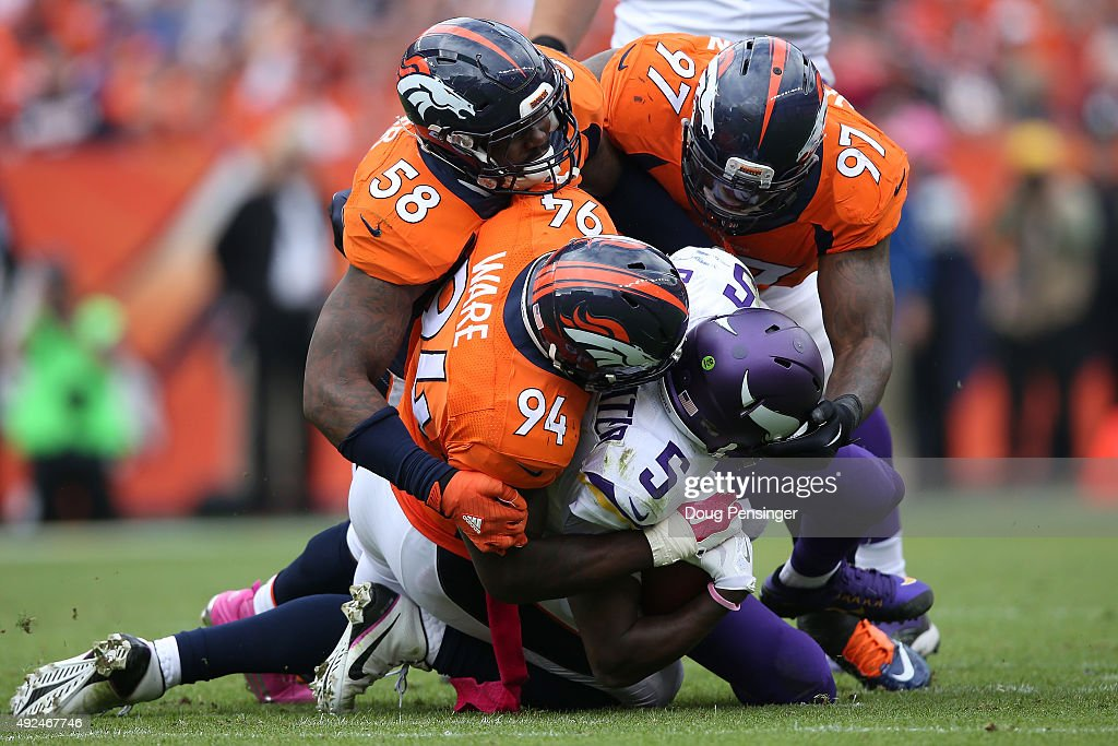 Outside linebacker Von Miller #58, outside linebacker DeMarcus Ware #94 and defensive end Malik Jackson #97 of the Denver Broncos gang tackle quarterback Teddy Bridgewater #5 of the Minnesota Vikings at Sports Authority Field at Mile High on October 4, 2015 in Denver, Colorado. The Broncos defeated the Vikings 23-20.