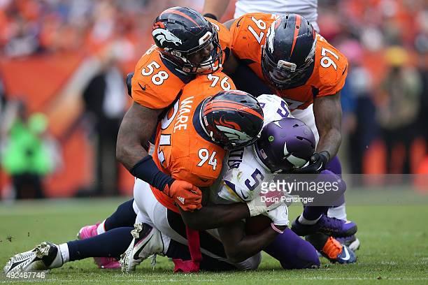 Outside linebacker Von Miller outside linebacker DeMarcus Ware and defensive end Malik Jackson of the Denver Broncos gang tackle quarterback Teddy...